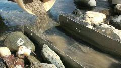 Prospector feeding sluice box Stock Footage
