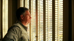 Man thinking at window Stock Footage