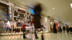 People in modern shopping centre - stock footage