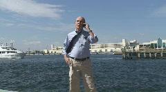 Businessman at harbor Stock Footage