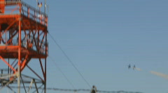 Air Force L-39 Patriot Series - 14 - distance fly-by behind radar tower Stock Footage