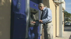 Businessman at ATM Stock Footage