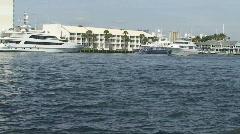 Luxury motor yacht cruising up waterway Stock Footage