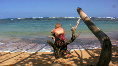 Enjoying a quiet moment on a tropical beach Stock Footage