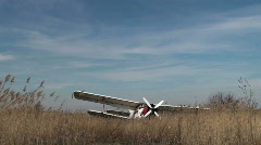 Old crashed air-plane in a field– time lapse Stock Footage