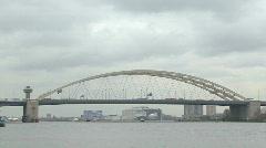 Huge bow bridge over river Stock Footage