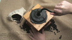 Grinding Coffee Beans The Hard Way - stock footage