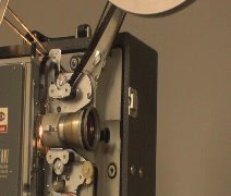 Side view of film projector (w/ sound) Stock Footage