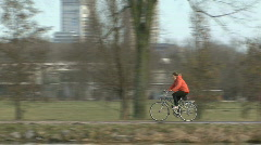 Woman on a bicycle on a dyke in Holland Stock Footage