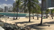 Stock Video Footage of Puerto Rico - Condado: People at La Concha Beach 1