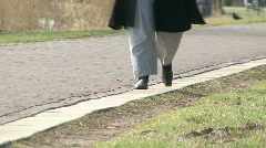 Overweight lady strolls by  Stock Footage