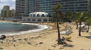 Stock Video Footage of Puerto Rico - Condado - people at La Concha Beach 2