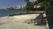 Stock Video Footage of Puerto Rico - Condado Lagoon: empty lonely bench small pasive park, Puerto Rico