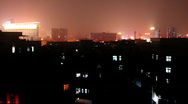 Houses silhouetted against chinese city at night Stock Footage