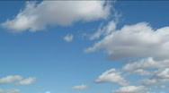 Stock Video Footage of White clouds moving over blue sky. HD quality.