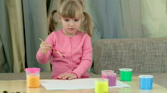 Girl child draws paint Stock Footage
