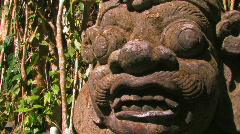 Demon temple guardian sculpture Bali GOD scary frightening face bulging eyes  Stock Footage