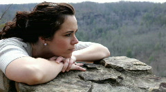 Pan of Girl resting head on rock - stock footage