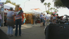 Crowds in time lapse - 2 - street fair tents - stock footage