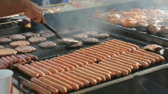 Street fair event - 2 - 8 - grilling hamburgers and  hot  dogs - stock footage