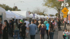 Crowds in time lapse - 3 - street fair tents high angle - stock footage
