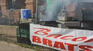 Street fair event - 2 - 6 - smoking grill Stock Footage