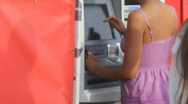 Woman at ATM - 1 - entering data Stock Footage