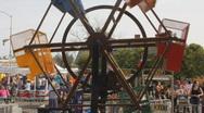 Street fair event - 1 - 8 - mini ferris wheel Stock Footage