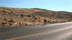 Triathlon cyclist Stock Footage