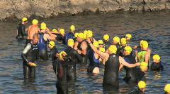 Triathlon swimmers getting ready Stock Footage
