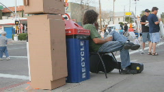 Street fair event - 1 - 3 - relaxing at the street corner Stock Footage