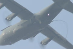 C130 Hercules with paratroopers jumping from the exit door Stock Footage