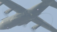 Stock Video Footage of C130 Hercules with paratroopers jumping from the exit door