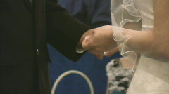Bride plays with groom's ring Stock Footage