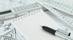 notepad, pen and architectural drawings - stock footage