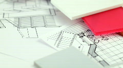 Plastics, metric folding ruler & architectural drawings - stock footage