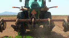 Farmer Tills Field Stock Footage