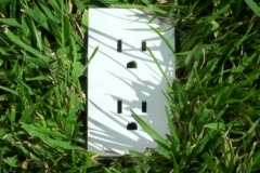 Power outlet in grass V3 - NTSC Stock Footage