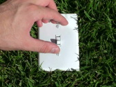 Light switch in grass V1 - NTSC Stock Footage