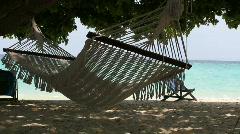 Hammock sways with the ocean breeze - stock footage