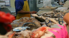 Fishmonger weighs product Stock Footage