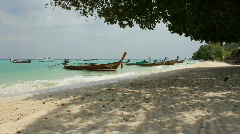 Longtail Boats Moored on Beach Stock Footage