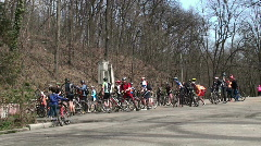 Mountain bikers celebrate victory by holding bikes over heads  Stock Footage