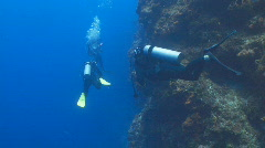 3 divers on SR wall Stock Footage