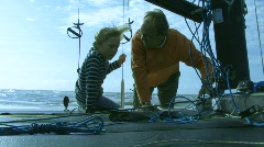 MS, Father giving son instructions on sailboat Stock Footage