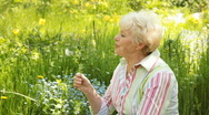 Stock Video Footage of Senior woman with dandelion