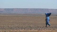 People Riding Camels Across Sahara Desert - stock footage