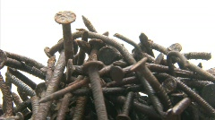 Stock Video Footage of A spinning rusty nails background