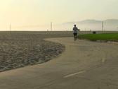 Exercising on boardwalk V1- NTSC Stock Footage