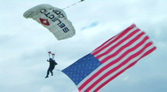 Stock Video Footage of Skydiver Parachuting With Flag